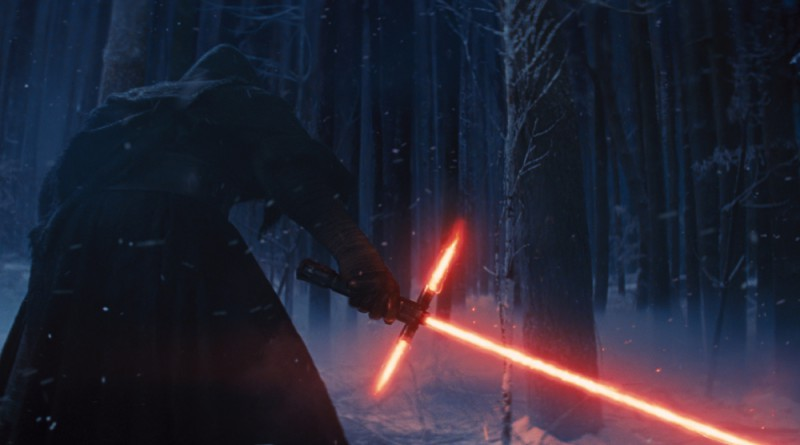 "This photo provided by Disney shows, Adam Driver as Kylo Ren with his Lightsaber in a scene from the new film, ""Star Wars: The Force Awakens."" The movie releases in the U.S. on Dec. 18, 2015. (Film Frame/Disney/Lucasfilm via AP) ORG XMIT: CAET177"
